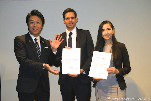 Fukuoka Mayor Soichiro Takashima, presents the first applicants for the Startup Visa, Thomas Pouplin and Yasmine Djoudi, with their Confirmation Letters of NBIP.